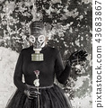 The girl in a gas mask. The threat of ecology.  43683867