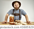 Germany, Bavaria, Upper Bavaria, man with beer dressed in traditional Austrian or Bavarian costume 43685929