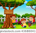 the children reading book and relax near the tree 43686041