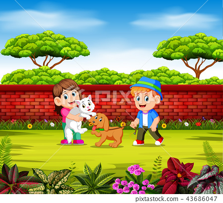 the children are playing with their pets  43686047
