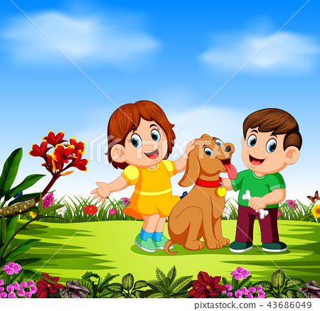 the children are playing with their dog  43686049