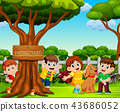 the happy children are playing near the big tree 43686052