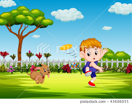 the boy are playing frisbee with his dog  43686055