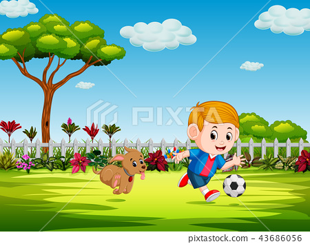 the boy playing soccer in the yard with his dog 43686056