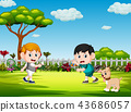 the children playing badminton and the dog  43686057