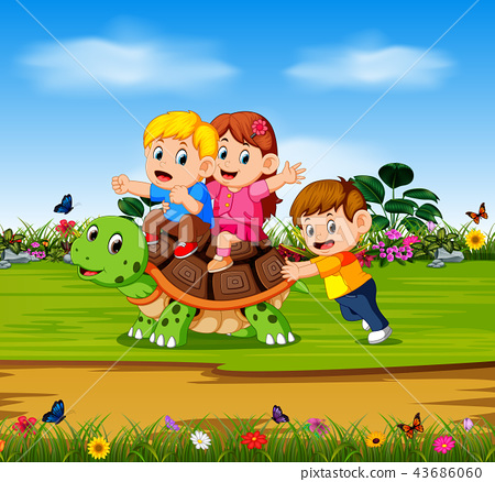 the three children are playing on the big turtle  43686060