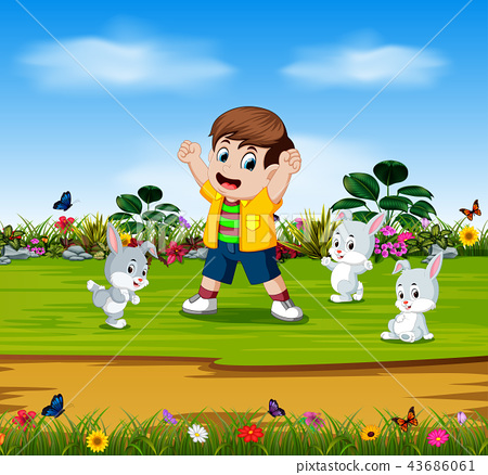 the boy are playing with three rabbits  43686061
