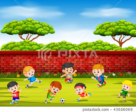 the children playing soccer with their team  43686069