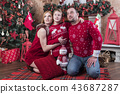 Family portrait at Christmas tree 43687287