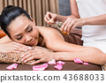 Woman receiving massage 43688033