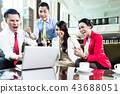 Successful business people celebrating in office 43688051