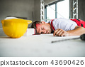 An unconscious man worker lying on the floor after accident on the construction site. 43690426