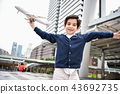 Children's play concept. The boy is playing with toys. Boy playi 43692735