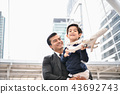 Family concept. Dad and son are playing fun toys. A businessman 43692743
