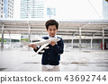 Children's play concept. The boy is playing with toys. Boy playi 43692744