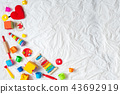 Kids colorful toys frame on white background.  43692919