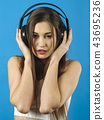 Beautiful woman listening to headphones 43695236