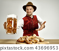 Germany, Bavaria, Upper Bavaria, man with beer dressed in traditional Austrian or Bavarian costume 43696953