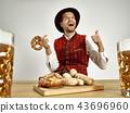 Germany, Bavaria, Upper Bavaria, man with beer dressed in traditional Austrian or Bavarian costume 43696960