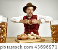 Germany, Bavaria, Upper Bavaria, man with beer dressed in traditional Austrian or Bavarian costume 43696971