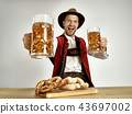 Germany, Bavaria, Upper Bavaria, man with beer dressed in traditional Austrian or Bavarian costume 43697002