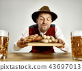 Germany, Bavaria, Upper Bavaria, man with beer dressed in traditional Austrian or Bavarian costume 43697013