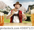 Germany, Bavaria, Upper Bavaria, man with beer dressed in traditional Austrian or Bavarian costume 43697123