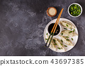 Asian dumplings, soy sauce, chopsticks, top view 43697385