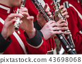 Clarinet musicians in red uniform 43698068