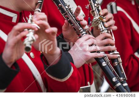 Clarinet musicians in red uniform 43698068
