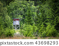 Wooden hunting tower in a green forest 43698293