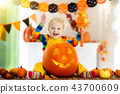 Kids in witch costume on Halloween trick or treat 43700609