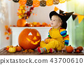 Kids in witch costume on Halloween trick or treat 43700610
