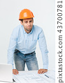 Stressed young constructor having headache or migraine looking exhausted and worried isolated on 43700781