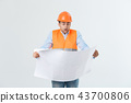 Shocked builder construction worker is holding in hand a plan draft document isolated on gray 43700806