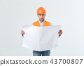 Shocked builder construction worker is holding in hand a plan draft document isolated on gray 43700807