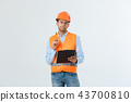 Portrait of Serious architect or engineer writing or taking notes on a clipboard isolated on white 43700810