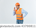 Angry engineer with angry face emotion shouting at someone raising his both hands, isolated on a 43700811
