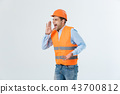 Angry engineer with angry face emotion shouting at someone raising his both hands, isolated on a 43700812