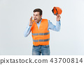 Angry engineer with angry face emotion shouting at someone raising his both hands, isolated on a 43700814