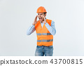Angry engineer with angry face emotion shouting at someone raising his both hands, isolated on a 43700815