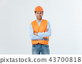 Smiling construction engineer posing with arms crossed. Isolated over grey background 43700818