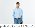 Portrait of happy fashionable handsome man in jeans and blue shirt look at camera 43700823