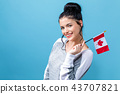 Young woman with a Canadian flag 43707821