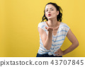 Young woman blowing a kiss 43707845