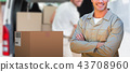 Composite 3d image of confident delivery man standing with arms crossed 43708960
