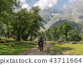 Travelling in summer, backpacker riding horse 43711664
