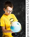 Schoolboy exploring world through a globe 43715272