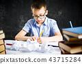 Schoolboy finishing homework at home 43715284