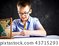 Boy solving math problems at home 43715293